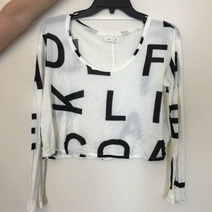 White crop top with letters and long sleeves